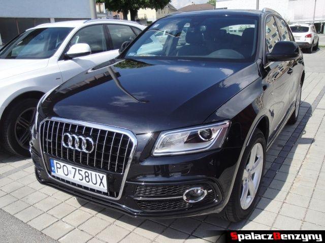 Audi Q5 2.0 TDI czarne na parkingu hotelowym